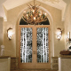 1-Carved Thermal Unit Front Entry Glass with Aspen Trees and leaf detail      Also Shown: Fallow Bell Sconces and Elk Antler Chandelier