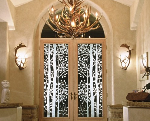 Custom Front Door with Chandelier and Sconces and a link to our Portfolio